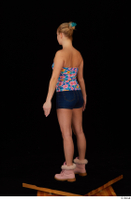 Cayla Lyons jeans shorts pink winter shoes standing strapless top whole body 0004.jpg